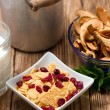 Upper view on square bowl full of cornflakes with berries — Stock Photo #73981765