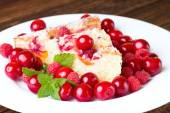 Fruit pie on plate with cherries and raspberries — Stock Photo