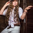 Cute teenager girl in a cowboy hat — Stock Photo #59910501