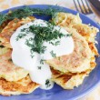 Fried zucchini fritters with sour cream  — Stock Photo #67729949