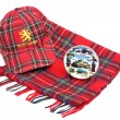 Scottish Red tartan cap, tartan scarves and souvenir plate — Stock Photo #52277737