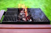Flaming charcoal and BBBQ Grill — Stock Photo