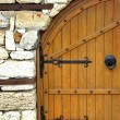Old Door or Gate in White Stone Wall — Stock fotografie #56830781