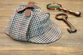 Deerstalker Hat, Retro Magnifying Glass and Large Old Key — Stock Photo