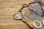 Sherlock Holmes Cap famous as Deerstalker, Key, Handcuffs and Ma — Stock Photo