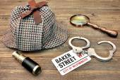 Detective Hat, Spyglass and Magnifier, sign Baker Street and han — Stock Photo