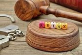 Sign Relax on the Soundboard, Judges Gavel, handcuffs and book i — Stock Photo