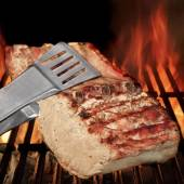 Tongs Holding Grilled Pork Ribs — Stock Photo