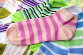 Stack Of Many Pairs Colorful Striped Socks Isolated On White — Stock Photo