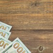 Usa New One Hundred Dollar Bills On The Wood Table — Stock Photo #70927561