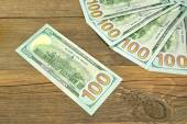 Five One Hudred Dollar Bill On The Rough Wood Background — Stock Photo