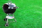 BBQ Charcoal Grill Appliance On The Lawn Background With Copy Sp — Stock Photo