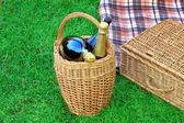 Basket With Champagne Wine, Picnic Hamper And Blanket — Stock Photo