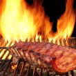 BBQ Pork Spare Ribs On The Hot Flaming Grill — Stock Photo #72005793