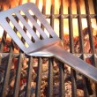 Spatula On The Hot Flaming Grill Close-up — Stock Photo #72797903