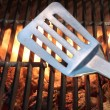 Spatula On The Hot Flaming Grill Close-up — Stock Photo #72797911
