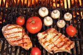 Pork Rib Steaks, Tomato And Mushrooms On Hot BBQ Grill — Stock Photo