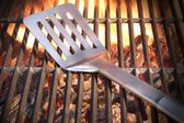 Spatula On The Hot Flaming Grill Close-up — Stock Photo