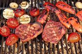 Two Flame Broiled Beef Steaks And Vegetables On BBQ Grill — Stock Photo
