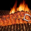 BBQ Roast Baby Back Pork Ribs Close-up On Hot  Grill — Stock Photo #73825925