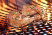 Two Chicken Quarter On The Hot BBQ Grill Close-up. — Stock Photo