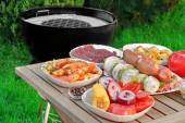 Close-up View On Wood Picnic Table  With Different Cookout Food — Stock Photo