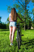 Girl outgoing with her bicycle — Stock Photo