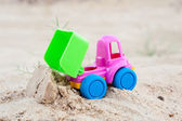 Unloading truck in the sands — Stock Photo