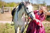 Horsewoman and white horse — Stock Photo