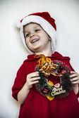 Boy and Christmas wreath — Stock Photo