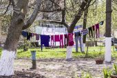 Launder clothes drying on a rope in the street — Stock Photo