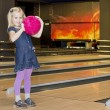 Plays a little girl in a bowling alley — Stock Photo #56974605