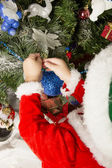 Boy decorates a Christmas tree — Stock Photo