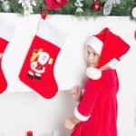 Little girl in santa hat smile — Stock Photo #58510527