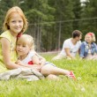 Sisters sitting on the meadow — Stock Photo #63548939