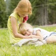 Sisters sitting on the meadow — Stock Photo #63548941