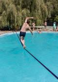 People walk on the sling over the water — Stock Photo