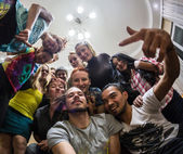 Merry Company at a house party — Stock Photo