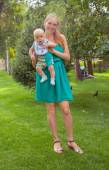 Young mother walking with her baby in the park — Stock Photo