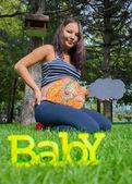 Pregnant girl walking in park — Stock Photo