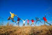 Young Adults jumping — Stock Photo