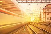 Departure of high speed train at sunset. — Stock Photo