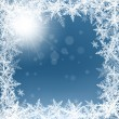 Christmas snowflakes and sun on blue background. — Stock Vector #58215871