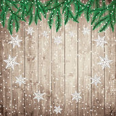 Fir tree branches and snowflakes on the wooden board. — Stock Vector