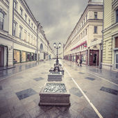 Wet evening city street at snowy weather time. — Стоковое фото