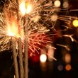 Three burning christmas sparklers. — Stockfoto #63076369