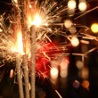 Three burning christmas sparklers. — Foto de Stock   #63076473
