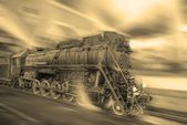 Steam train goes fast on the night station background.  — Foto Stock