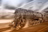 Steam train goes fast on the night station background. — Stock Photo