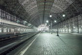 High speed train departs from the station. — Stock Photo
